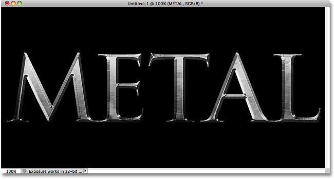 The metal text effect using Trajan Pro Bold. Image © 2010 Photoshop Essentials.com.